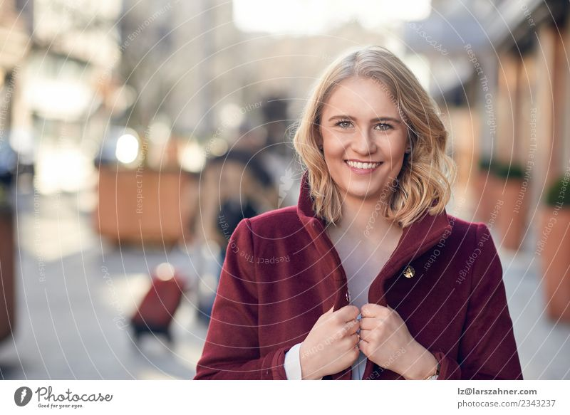 Attractive young blond woman with a friendly smile Style Happy Woman Adults 1 Human being 18 - 30 years Youth (Young adults) Autumn Fashion Coat Blonde Smiling