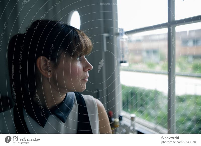 Woman looks outside from window. Human being Feminine Young woman Youth (Young adults) Adults 1 30 - 45 years Looking Beautiful Longing Wanderlust Earnest Bangs
