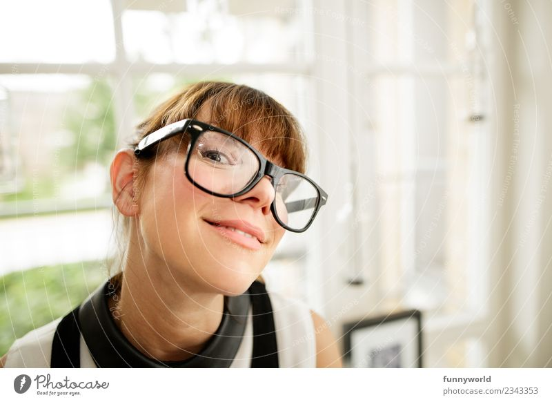 Woman with big glasses smiles in camera. Human being Adults 1 30 - 45 years Brash Happiness Beautiful Funny Nerdy Cute Smart Reliability Trashy Crazy Whimsical
