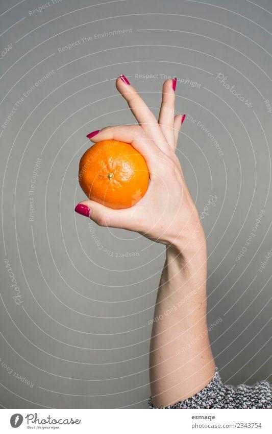 hand holding an orange in original shape Food Fruit Orange Nutrition Eating Breakfast Organic produce Vegetarian diet Diet Lifestyle Joy Healthy Health care