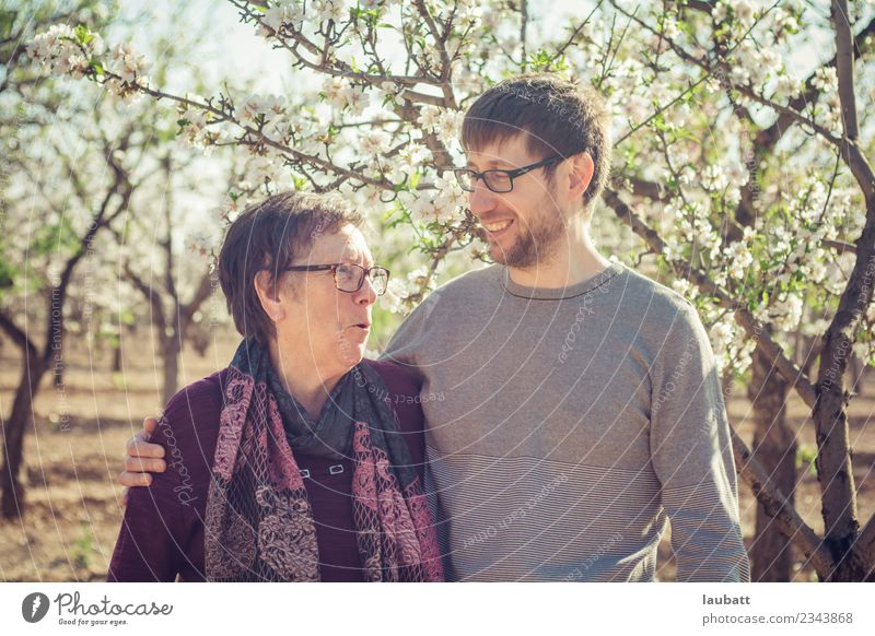 Mum and son talking and smiling Woman Human being Nature Man Flower Adults Lifestyle Blossom Spring Family & Relations Happy Together Authentic Female senior