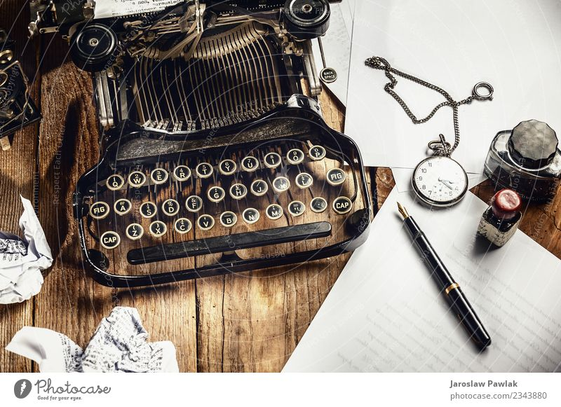 Text prescribed on a vintage typewriter and watch timekeeper. Design Office Business Technology Book Paper Metal Steel Rust Old Write Retro Black White