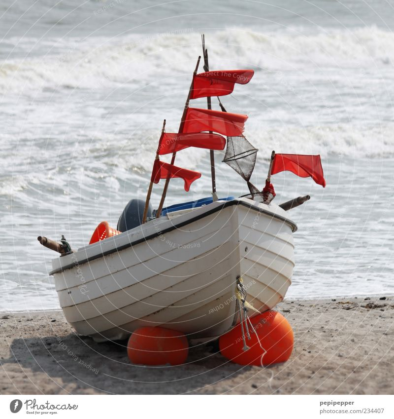 flag ship Summer Beach Ocean Waves Rope Engines Elements Sand Water Wind Coast Fishing boat Motorboat Wood Rust Lie Wait Colour photo Exterior shot Day Deserted