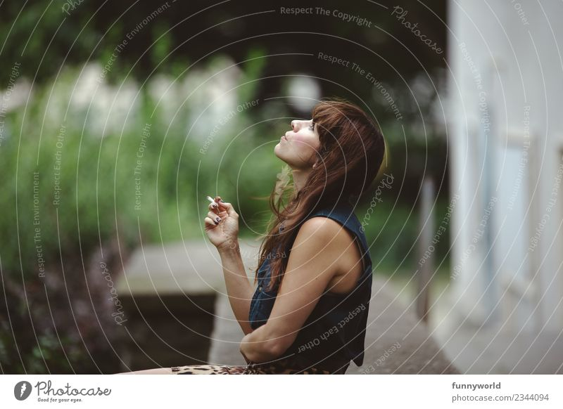 Woman sitting in the backyard smoking. Feminine Young woman Youth (Young adults) Adults 1 Human being 30 - 45 years Breathe Relaxation Smoking Looking Summer