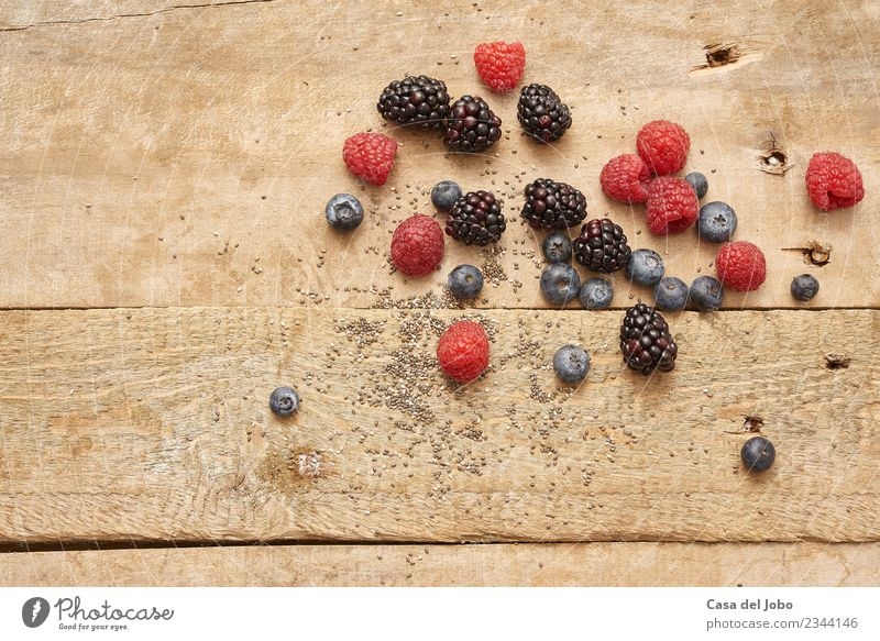 different fresh berries on rustic wooden background Food Fruit Nutrition Organic produce Vegetarian diet Diet Lifestyle Healthy Eating Authentic Good Delicious