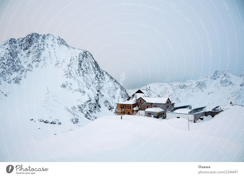 House in the mountains Mountain Rock Peak Snowcapped peak Mountain ridge Alps Winter White Cold Sky Twilight House (Residential Structure) Hut Monochrome Sparse