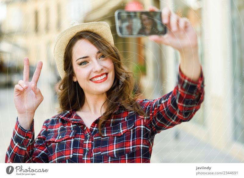 Young woman selfie in the street with a smartphone Style Joy Happy Beautiful Hair and hairstyles Face Vacation & Travel Telephone PDA Camera Human being