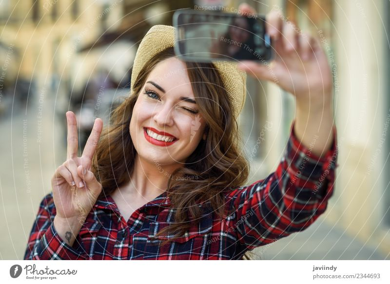 Young woman selfie in the street with a smart phone Style Joy Happy Beautiful Hair and hairstyles Face Vacation & Travel Telephone PDA Camera Human being