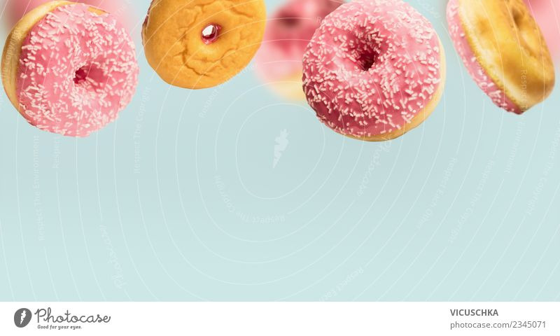 Pink doughnuts on blue Cake Nutrition Style Design Donut To fall Floating Food photograph Eating Background picture Colour photo Interior shot Studio shot