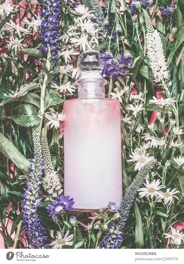 Natural cosmetics. Pink cosmetics bottle on flowers and plants Shopping Style Design Beautiful Cosmetics Perfume Healthy Wellness Spa Summer Nature Plant Flower