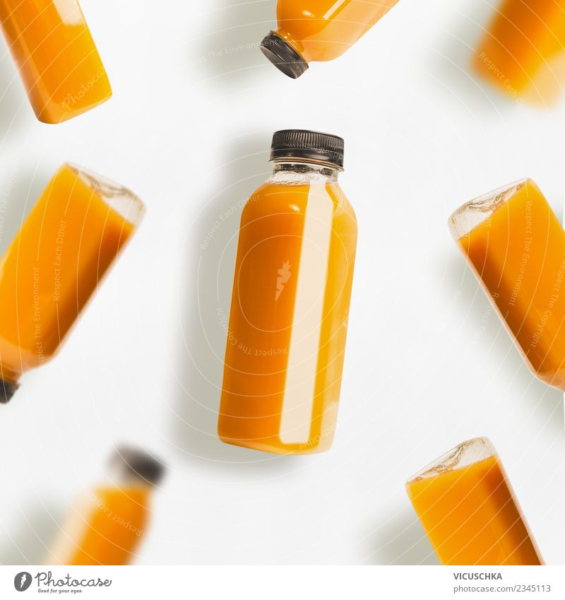 Yellow smoothie or juice bottles on white background Food Organic produce Vegetarian diet Diet Beverage Cold drink Bottle Style Design Healthy Eating