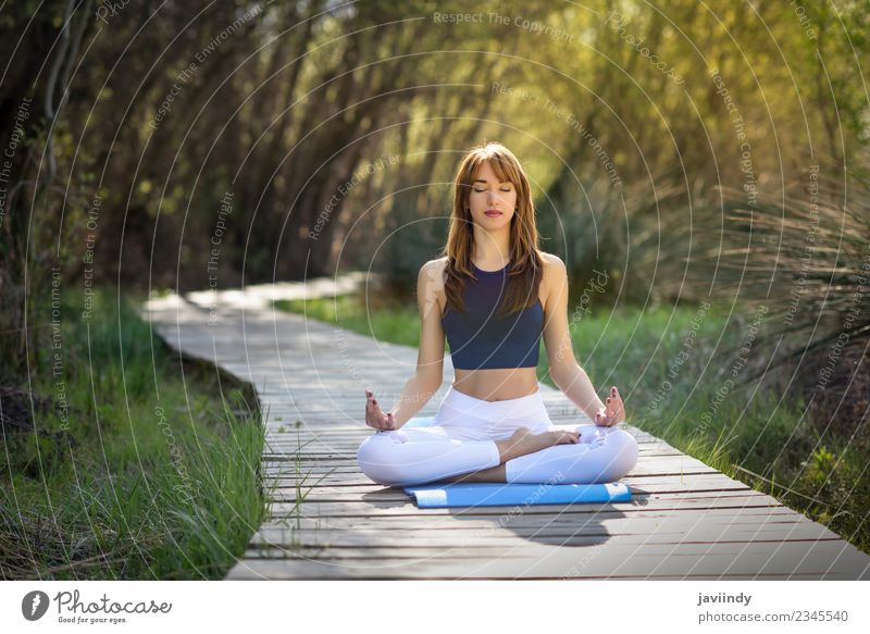 Young woman doing yoga in nature. Lifestyle Relaxation Meditation Summer Sports Yoga Human being Feminine Youth (Young adults) Woman Adults 1 18 - 30 years