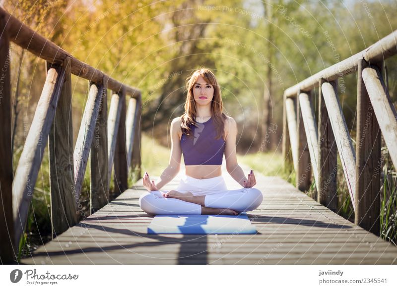 Young woman doing yoga in nature Woman Human being Nature Youth (Young adults) Summer Relaxation Calm 18 - 30 years Adults Lifestyle Natural Sports Grass Sit