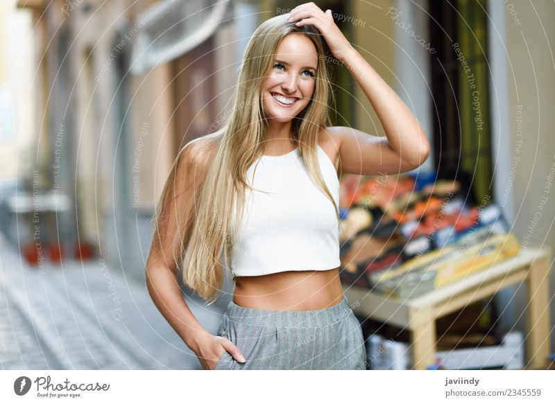 Smiling young woman in urban background. Woman Human being Youth (Young adults) Young woman Summer Beautiful White Joy 18 - 30 years Adults Street Lifestyle