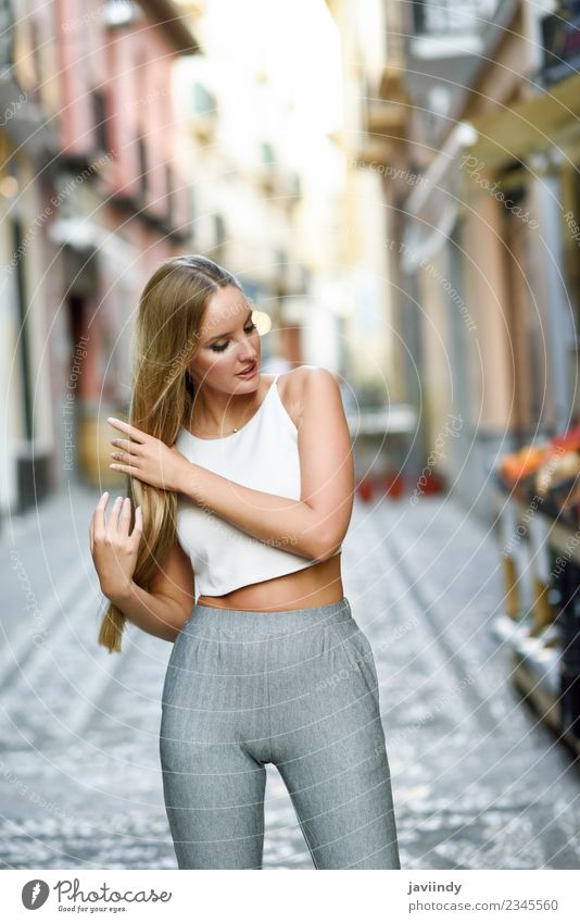 Young woman touching her hair in urban street Lifestyle Elegant Style Happy Beautiful Hair and hairstyles Summer Human being Feminine Youth (Young adults) Woman