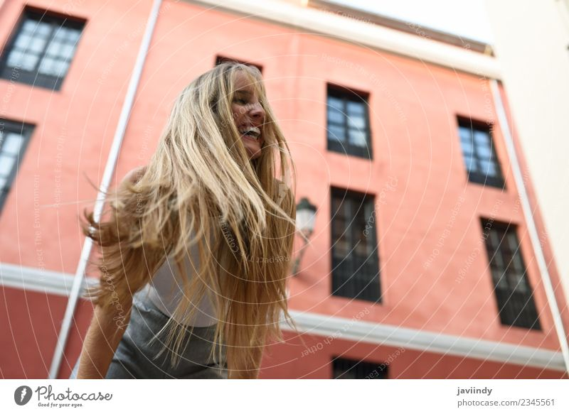 Happy young woman with moving hair in urban background Beautiful Hair and hairstyles Summer Human being Feminine Young woman Youth (Young adults) Woman Adults 1