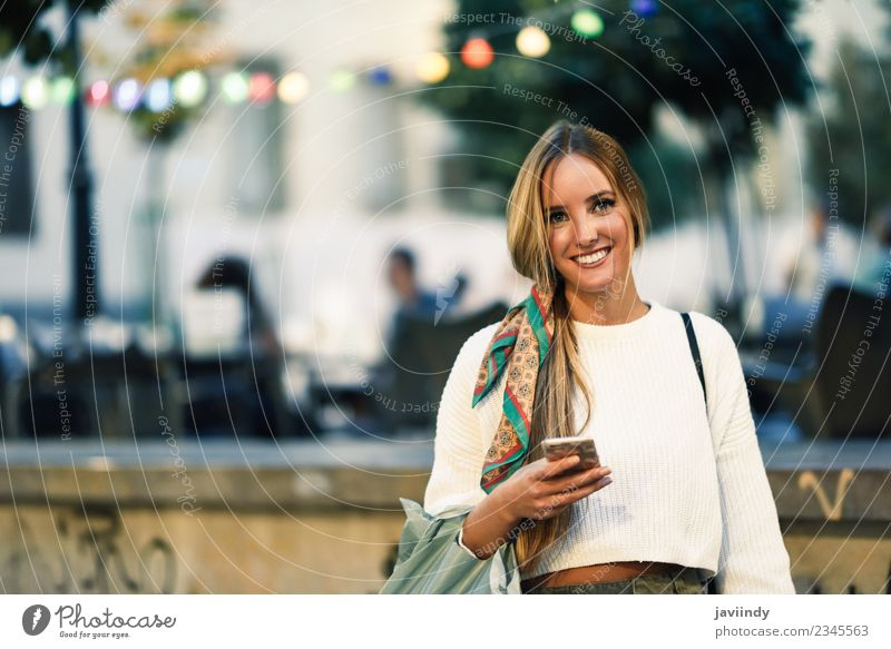 Blonde woman with smart phone in the street. Woman Human being Youth (Young adults) Young woman Beautiful White 18 - 30 years Adults Street Lifestyle Feminine