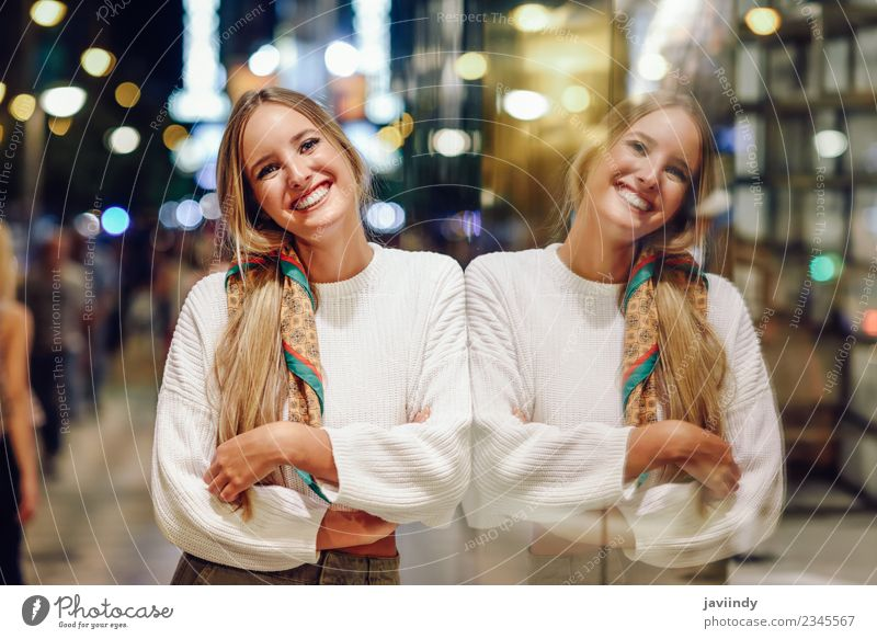 Young woman at night reflected in a shop window. Woman Human being Youth (Young adults) Beautiful Joy 18 - 30 years Street Adults Feminine Style Fashion Blonde