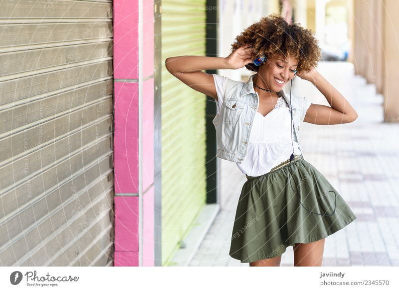Black woman listening to the music with headphones Woman Human being Youth (Young adults) Young woman Joy 18 - 30 years Adults Street Lifestyle Feminine