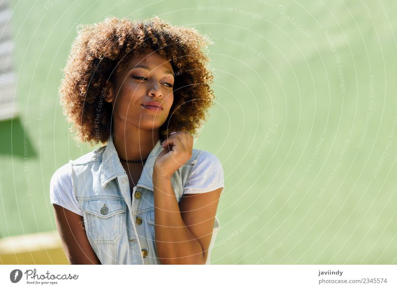Young black woman, afro hairstyle, smiling outdoors Woman Human being Youth (Young adults) Young woman Beautiful 18 - 30 years Black Face Adults Street