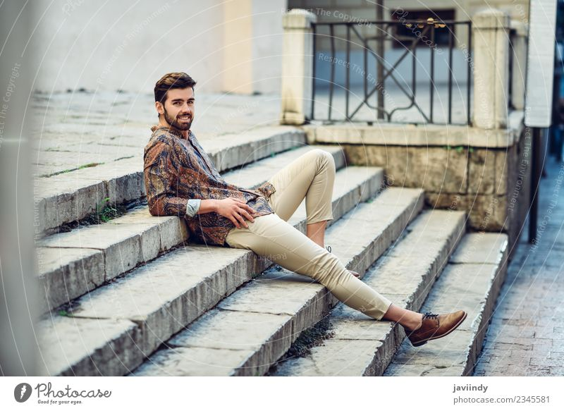 Young smiling man sitting on urban steps Human being Youth (Young adults) Man Beautiful Young man White 18 - 30 years Adults Street Lifestyle Autumn Style