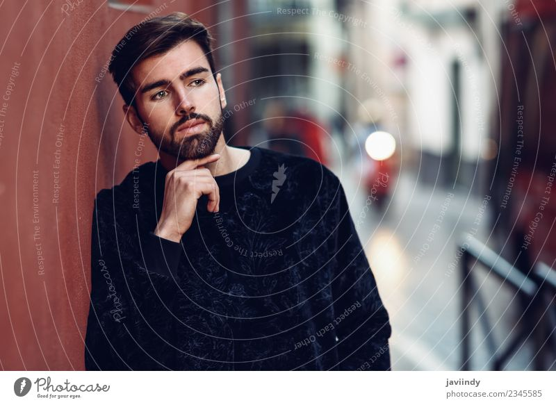 Young bearded man, model of fashion, in urban background Human being Youth (Young adults) Man Beautiful Young man White Red 18 - 30 years Black Adults Street