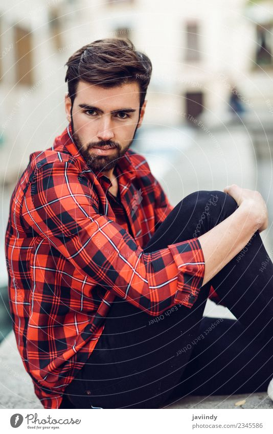 Man wearing plaid shirt sitting outdoors Human being Youth (Young adults) Beautiful Green Young man White Red 18 - 30 years Adults Street Lifestyle Autumn Style