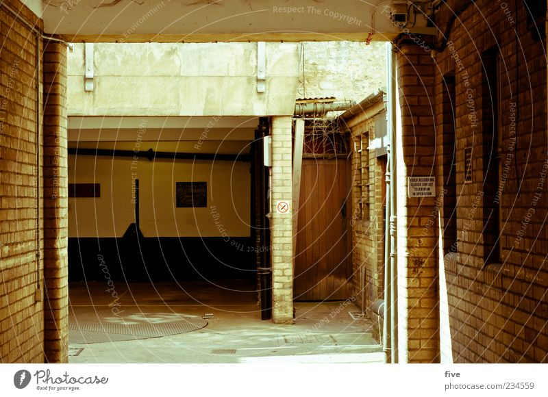 House (Residential Structure) Dark Window Cold Wall (building) Wall (barrier) Door Signs and labeling Places Gloomy Brick England Parking lot Garage Remote