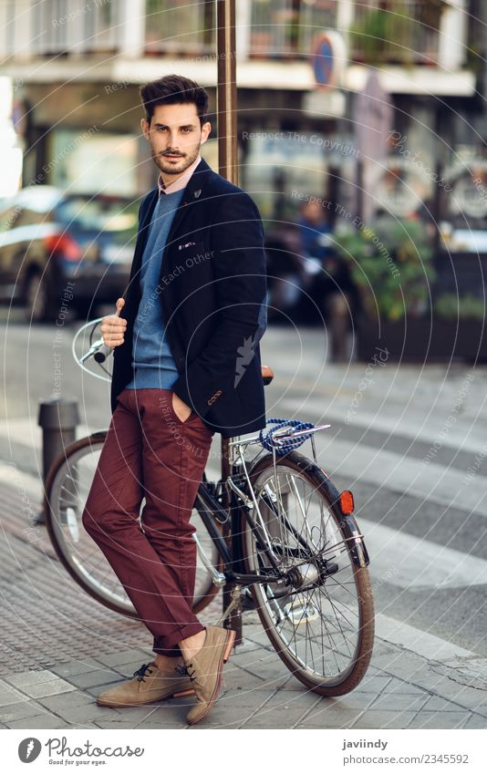 Man in the street wearing suit near a vintage bicycle. Lifestyle Elegant Style Beautiful Hair and hairstyles Business Human being Masculine Young man