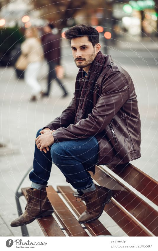 Thoughtful young man sitting on an urban bench Lifestyle Style Beautiful Hair and hairstyles Human being Masculine Young man Youth (Young adults) Man Adults 1