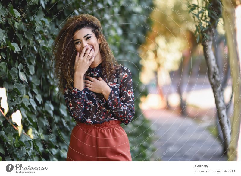 Beautiful young arabic woman laughing Lifestyle Joy Hair and hairstyles Human being Young woman Youth (Young adults) Woman Adults 1 18 - 30 years Autumn Street