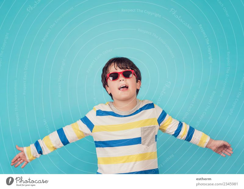 happy boy with sunglasses on blue background Child Human being Blue Joy Emotions Movement Boy (child) Happy Freedom Friendship Masculine Infancy Success Smiling