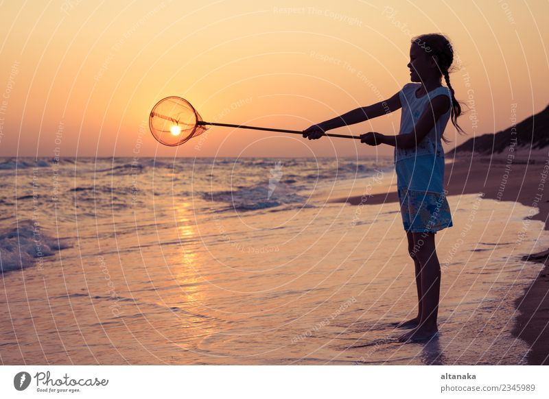 One happy little girl playing on the beach at the sunset time. Lifestyle Joy Happy Beautiful Relaxation Leisure and hobbies Playing Vacation & Travel Trip
