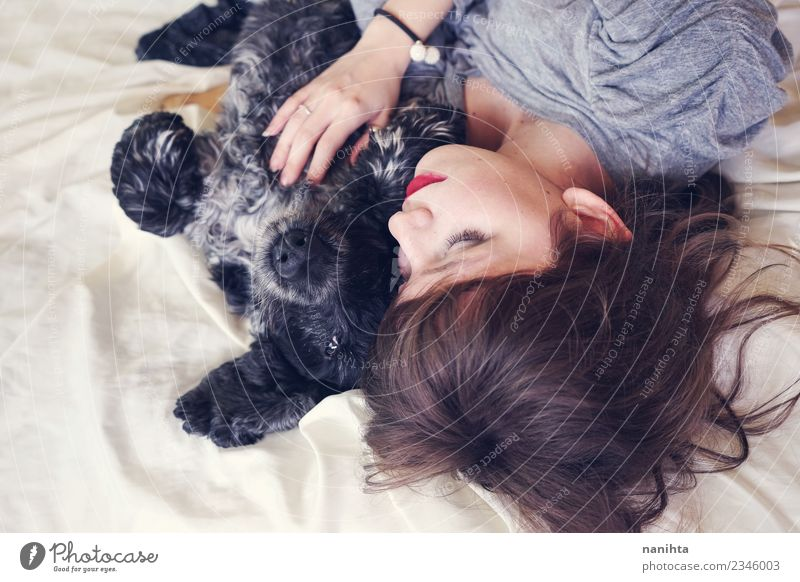 Young woman sleeping with her dog Lifestyle Beautiful Relaxation Bed Human being Feminine Youth (Young adults) Friendship 1 18 - 30 years Adults Animal Pet Dog