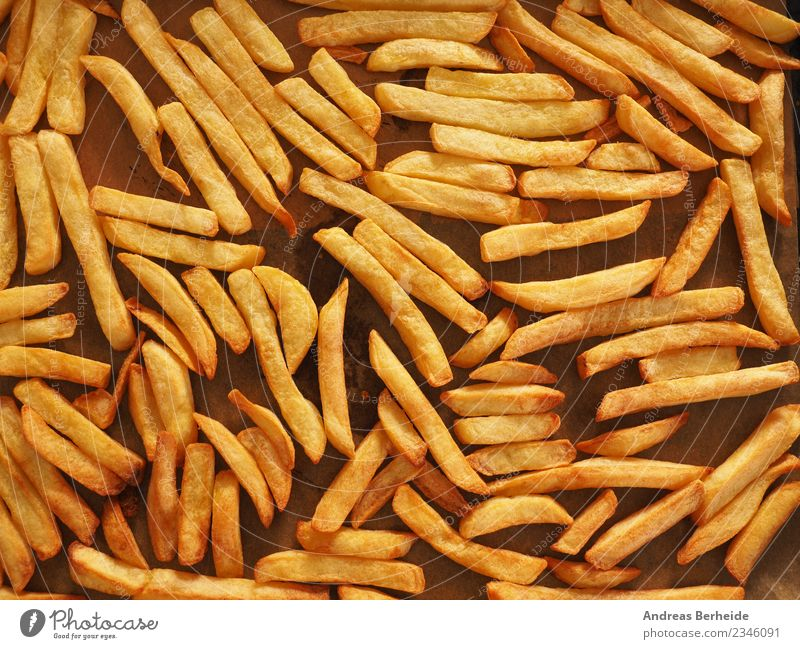 Oven French fries from organic potatoes Nutrition Lunch Organic produce Vegetarian diet Style Delicious Yellow natural baked baking sheet food