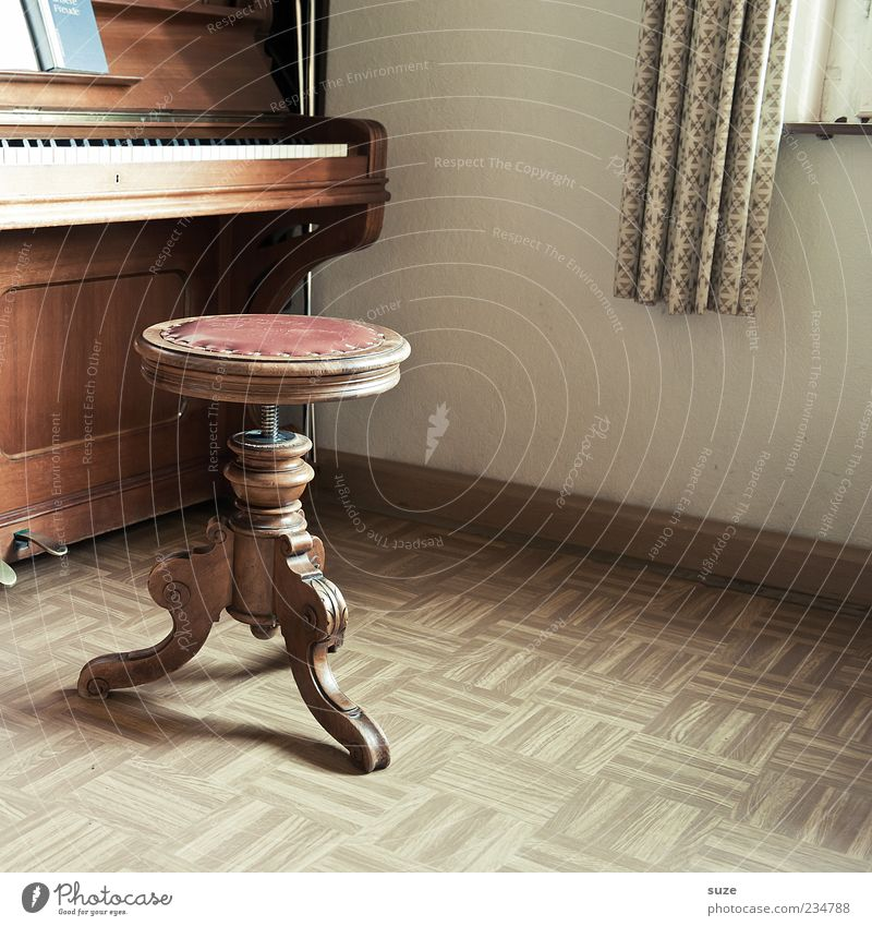 wooden toy Leisure and hobbies Living or residing Flat (apartment) Music Piano Wood Old Brown Past Stool Linoleum Floor covering Keyboard Sound Piano stool