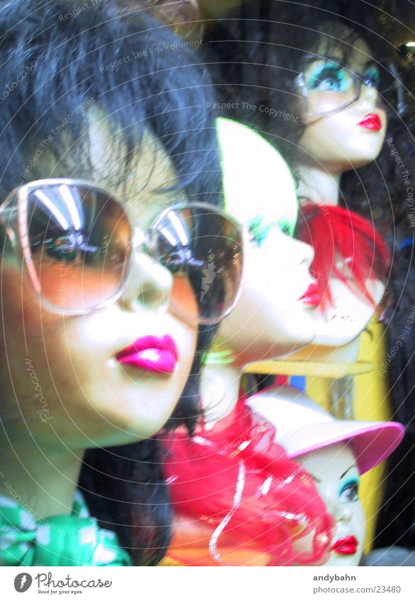 Hair and hairstyles Head Decoration Store premises Doll Shop window Photographic technology Wig