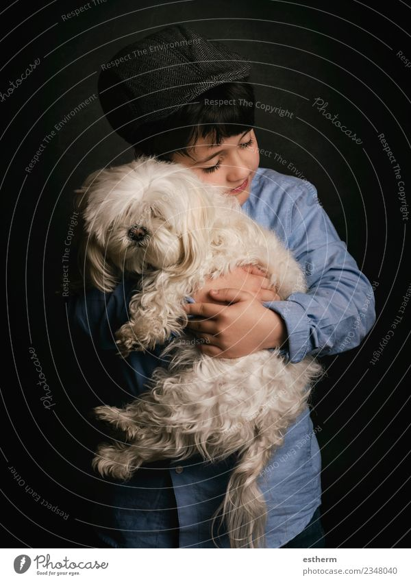 boy hugging his dog Lifestyle Joy Human being Masculine Child Boy (child) Infancy 1 3 - 8 years Cap Animal Pet Dog To hold on Smiling Laughter Love Friendliness