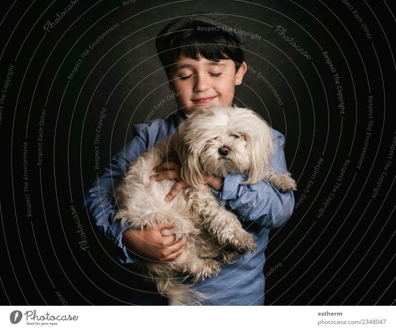 boy hugging his dog Lifestyle Joy Human being Masculine Child Boy (child) Infancy 1 3 - 8 years Accessory Cap Animal Pet Dog To hold on Smiling Laughter