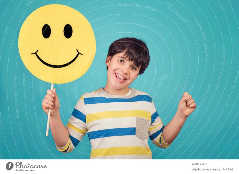 A kid holding a happy emoticon face Lifestyle Joy Human being Masculine Child Boy (child) Infancy 1 3 - 8 years To hold on Fitness To enjoy Smiling Laughter