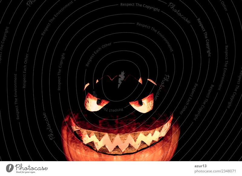 Scary carved Halloween pumpkin laughs ironically Hallowe'en Head Eyes Mouth Art Nature Autumn Glittering Smiling Laughter Illuminate Aggression Old Threat Dark