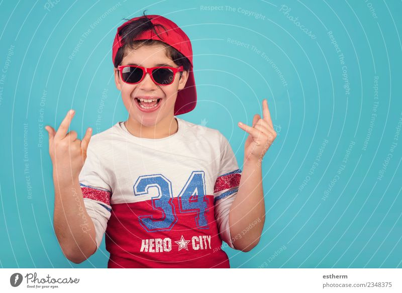 funny child with cap and sunglasses Human being Child Boy (child) Infancy 1 8 - 13 years Sunglasses Cap Smiling Laughter Funny Modern Emotions Happiness