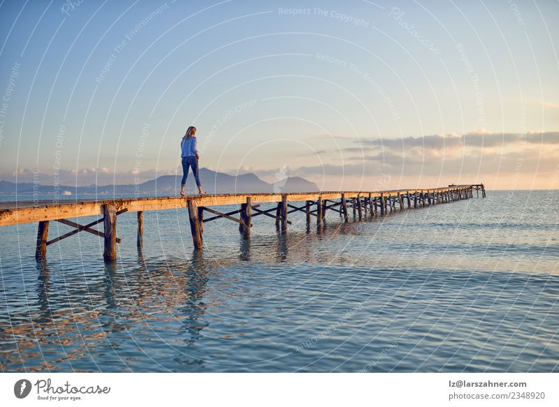 Woman walking along a wooden pier at sunset Human being Sky Nature Vacation & Travel Summer Beautiful Landscape Sun Ocean Relaxation Beach Adults Lifestyle Wood