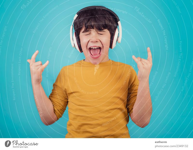 Boy with headphones showing rock sigh Child Human being Joy Lifestyle Funny Emotions Boy (child) Party Moody Masculine Infancy Music Smiling Happiness To enjoy