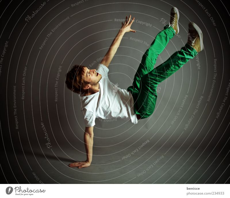 Human being Man Youth (Young adults) Movement Dance Masculine Cool (slang) T-shirt Jeans To fall Athletic Isolated Image Acrobat Dancer Trick Acrobatics
