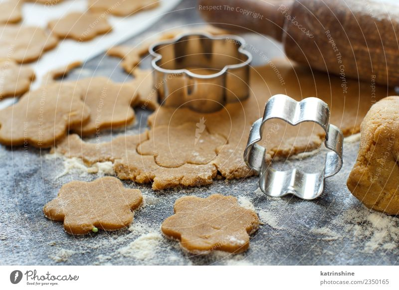Cooking cookies with cookie cutters on a dark table Dough Baked goods Dessert Kitchen Flower Metal Make Brown Tradition Baking Bakery biscuit cooking