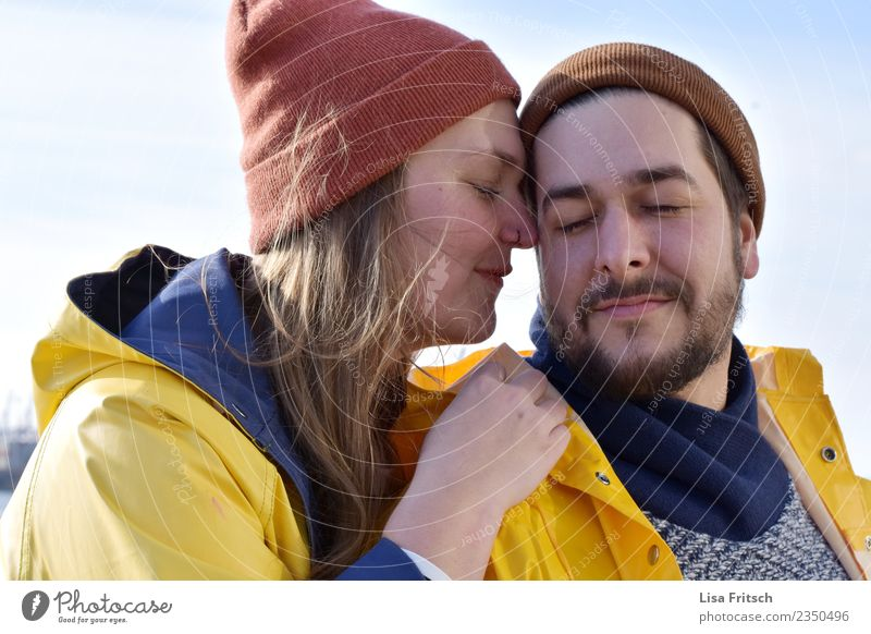 pair - caps - eyes closed Young woman Youth (Young adults) Young man Couple Partner 2 Human being 18 - 30 years Adults Rain jacket Facial hair Breathe Touch