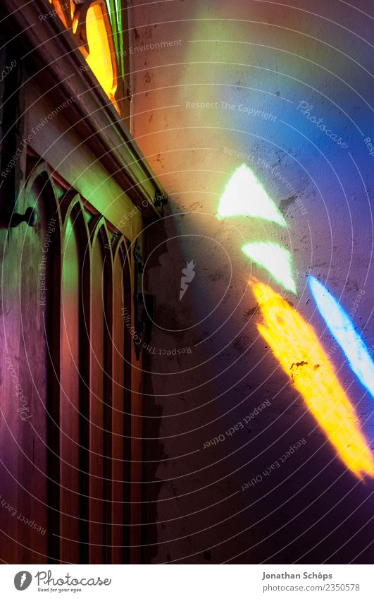 colorful light falls through a church feast Art Esthetic Moody Church Religion and faith Stained glass Church window Church door Illuminate Belief Ray of hope