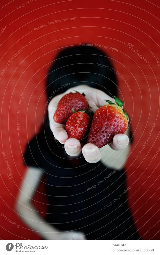 Young woman holding strawberries in her hand Human being Youth (Young adults) Beautiful Red 18 - 30 years Black Adults Eating Lifestyle Healthy Feminine Food
