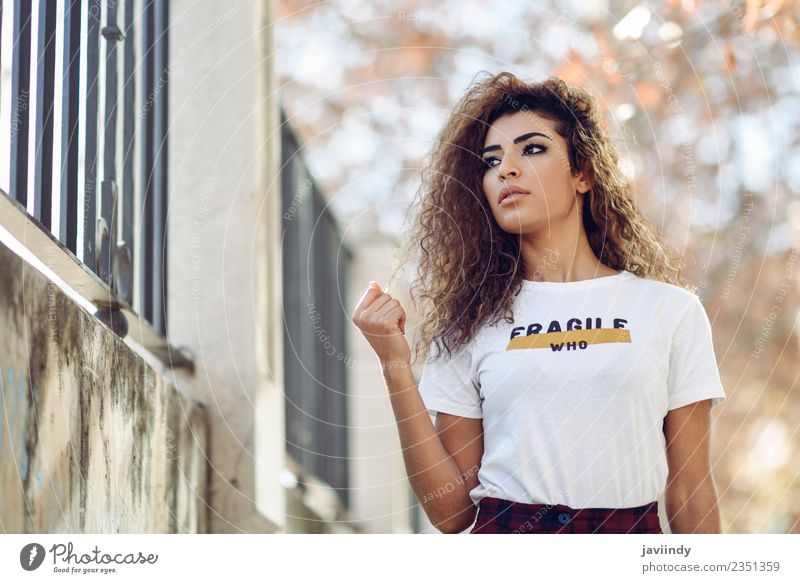 Beautiful young arabic woman with black curly hairstyle Lifestyle Style Hair and hairstyles Face Human being Young woman Youth (Young adults) Woman Adults 1